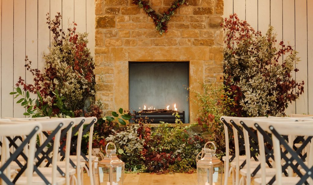 fireplace design, surrounded by foliage