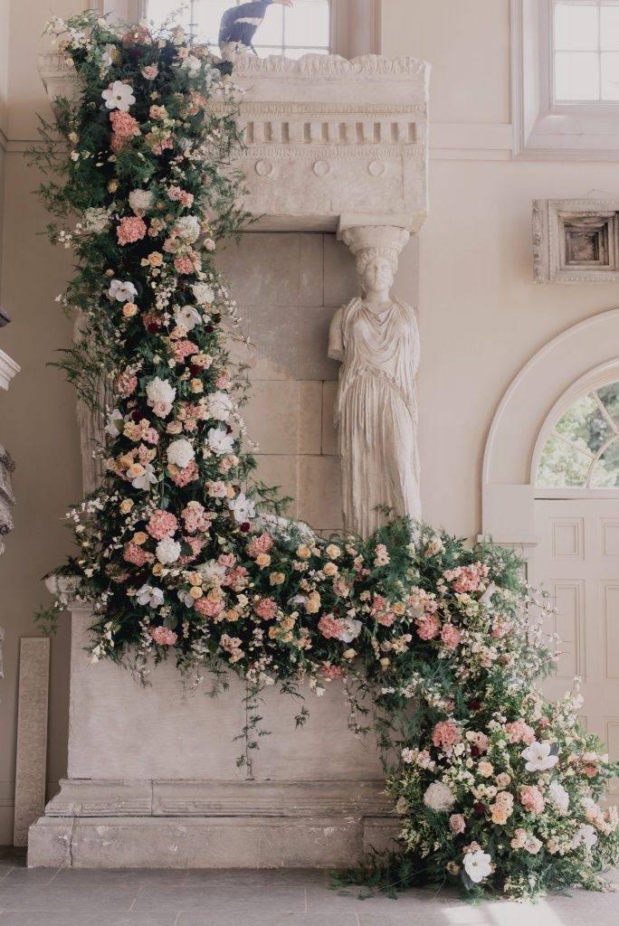 20ft floral cascade framed the couple as they said their vows at Aynhoe Park
